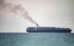 Ship on sea releasing a lot of exhaust gases