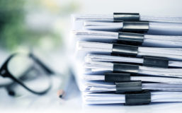 Documents with paper clip folder